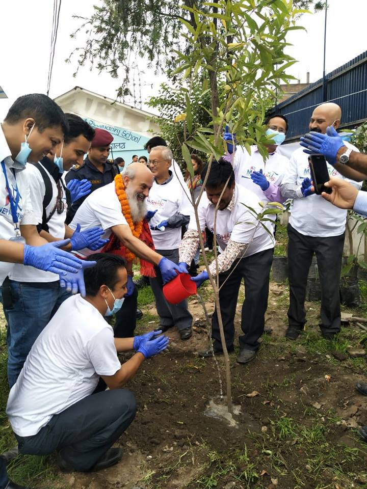 Ambassador along with Prinicipal of the School and Shalom Club members Planting.jpg