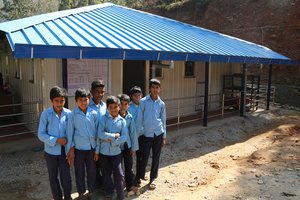 Children from Phulpingkot, Sindhupalchowk seem happy after a newly constructed health post was handed over to their earthquake affected community_health post constructed by World Vision.jpg