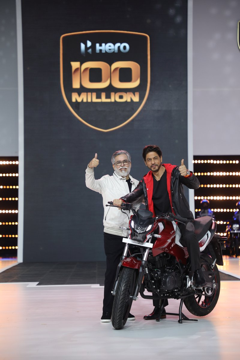 Dr. Pawan Munjal- Chairman and CEO, Hero MotoCorp with global movie icon, Shah Rukh Khan at the unveiling of the company's 100 millionth motorcycle - The Xtreme 160R (1).JPG