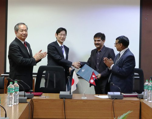 Grant Agreement exchanged between Mr. Baikuntha Aryal MOF and Mr. Jun Sakuma JICA.jpg