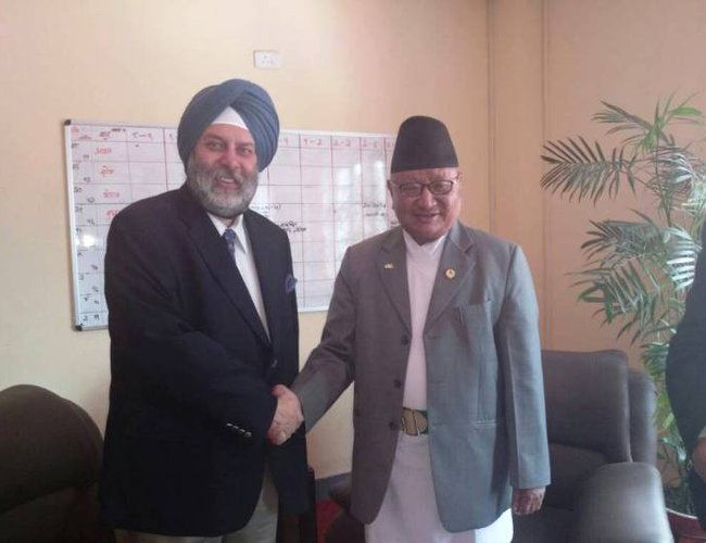 Indian ambassador Puri with Minister of Education Gopal Man Shrestha.jpg