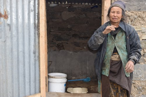 Kamisya Tamang,50, a person with disability of Grang Village of Kalika Rural Municipality -1 with recently built inclusive toilet Photo 2.JPG