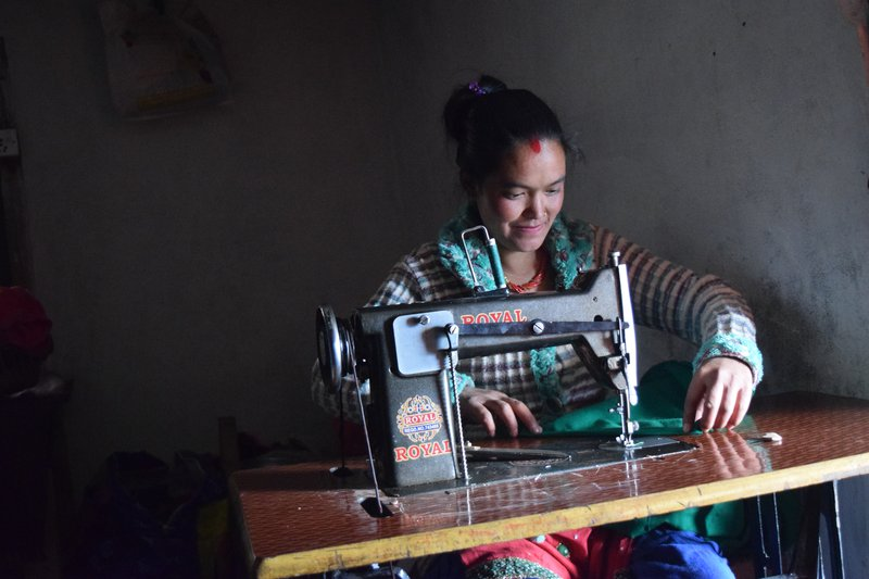 Kopila BK of Chankhu Village with her new sewing machine.jpg
