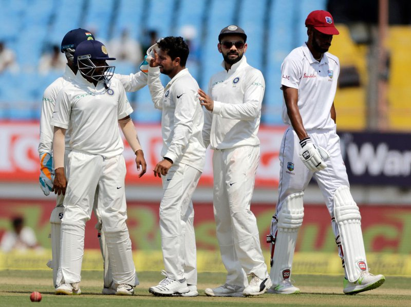 Kuldeep-Yadav-celebrates-with-his-team-mates-1st-Test.jpg
