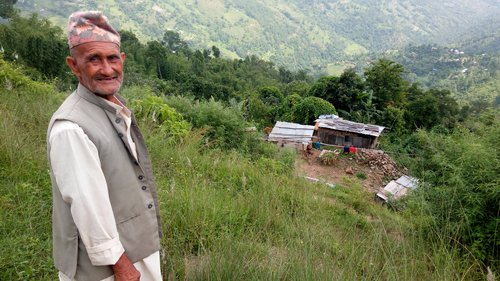 Mahendra Bdr Ghimire of Dhankuta shows his destroyed house.jpg