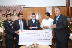 NIC-Asia Bank handed over the check for flood victims