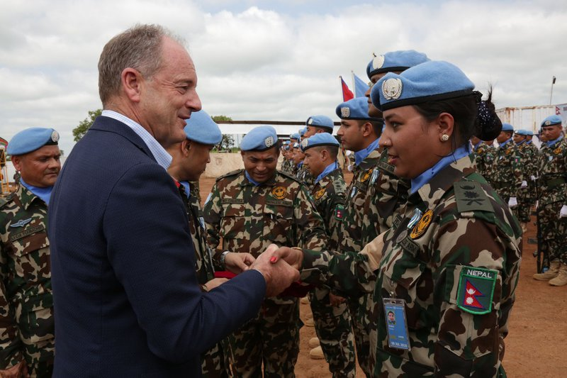 Nepalese peace Keepers in Sudan receiving award.jpg