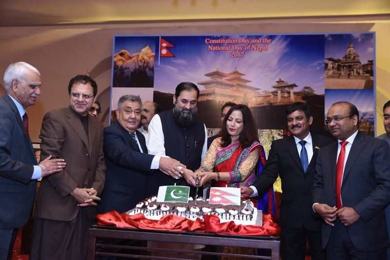 Nepali Embassy in Pakistan hosted reception Cake cutting.jpg