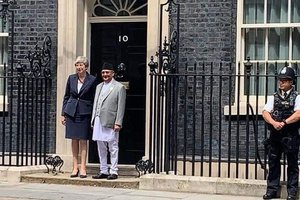 Oli with British PM.jpg