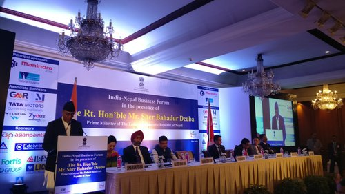 Prime Minister Deuba addressing business community in India.jpg