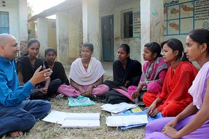 Priyanka-2nd-from-right-and-her-friends-discssing-their-plans-against-child-marriage-with-UNFPA-District-Officer-Bhav-Nath-Jha-left_newsbanner.jpg