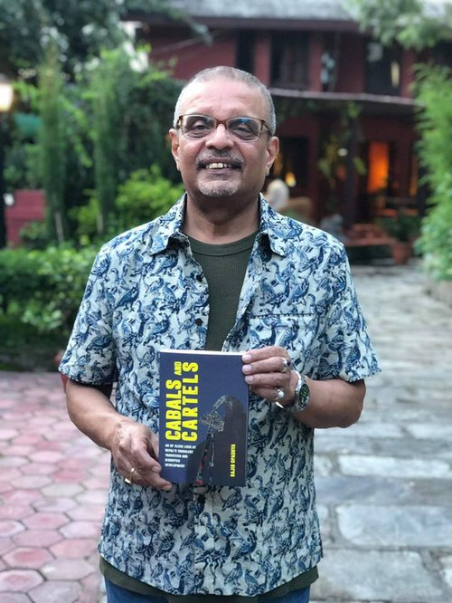 Rajib with his book.jpg