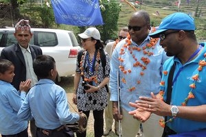 UN team being greeted by visually imparied boy playing madal in bhumiraj primary school in sunkuda village of bajhang.jpg