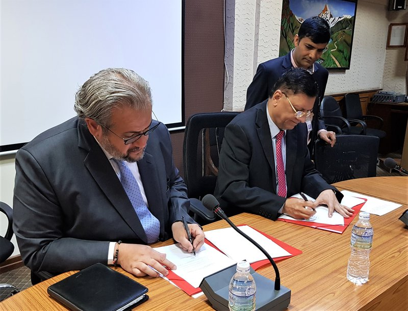 World Bank Country Manager for Nepal, Faris H. Hadad-Zervos, and Secretary, Lal Shanker Ghimire, signing agreement.jpg