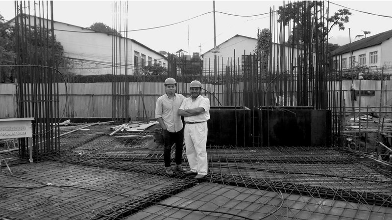 Yogendra Sakya with his son Rajul during the construction period.jpg